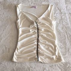Off white beaded tank top Love love love this too! Sad to see it go. Super cute v-neck tank top. Has blue, purple, and white beads down the middle, also has ruching. 92% polyester 8% spandex.               NO TRADES                                              make me an offer!  Lip stick Tops Tank Tops