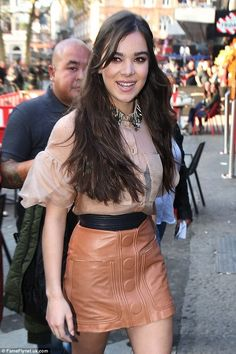 Sexy: The 19-year-old put on a leggy display in a thigh-skimming leather mini-skirt as she...