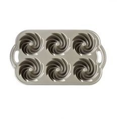 """Bake up to 6 elegant, adorable """"bundtlette"""" cakes with this high-quality mini bundt cake pan featuring a beautiful Heritage design."""