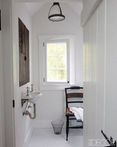 WITH A LIGHT TOUCH    The attic bath's sink and fittings are by Thomas Crapper & Co., and the cabinet is made of reclaimed wood and hardware.