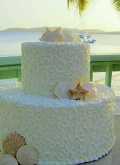 1284215346265 ShellsonSecretHarbour1cropped St Thomas wedding cake