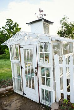 DIY rustic window greenhouse – Take the full tour of this hand built greenhouse made out of antique windows inside & out! Old Window Greenhouse, Diy Greenhouse Plans, Backyard Greenhouse, Small Greenhouse, Greenhouse Wedding, Greenhouse Plants, Backyard Play, Cottage Garden Design, Cottage Garden Plants