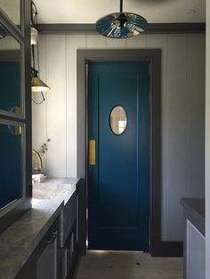 Steven Gambrel, Sag Harbor | cool butler's pantry, potting room or laundry Not sure. Interesting colors. Love the blue door.