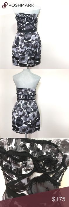 NWT - BCBG black and white floral cocktail dress NWT - BCBG black, white and gray floral strapless cocktail dress. Lightweight poly-silk floral printed woven. Strapless, sweetheart neckline with two pleated flowers and button detail at center. Removable spaghetti straps with adjustable slides. Accordion pleated bands cross bodice and extend around back. Ribbon waistband with mesh trim and pleated skirt. Approx 18'' long from natural waist BCBGMaxAzria Dresses Strapless