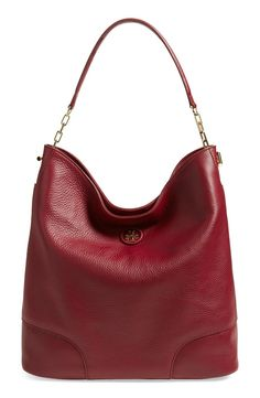 Obsessing over this leather hobo in a bold red by Tory Burch. Perfectly slouched and gold hardware make this spacious handbag a statement piece for everyday.