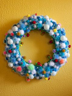 Bump up your holiday decor's warm-and-fuzzy factor with this playful wreath. Kids will love combining pom-poms of different sizes, textures and colors to create a one-of-a-kind look. Check local fabric stores for a readymade pom-pom garland to wrap around the foam wreath form to make quick work of covering the foam then layer on single pom-poms, attaching them with fabric or hot glue.
