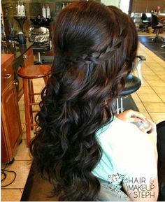 half up, curls with braid coming around the back from the front