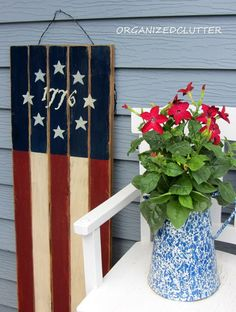 Another wooden flag sign on the left of the nicotiana.