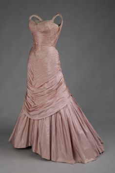 """tree"" Dress of light pink silk taffeta. Sweetheart bodice with thin straps. Fabric is shirred horizontally, with the shirring creating slight V-shapes from the bust to knee area. The bodice and upper hips are fitted, with the skirt belling out and away in back."