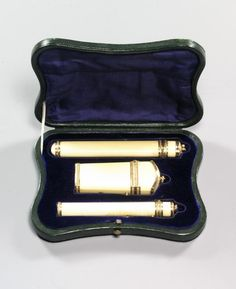 AN UNUSUAL GOLD-MOUNTED IVORY TOILET SET,THE KNIFE CASE AND NECESSAIRE MAKER'S MARK OF JEAN-BAPTISTE GILLET, CHARGE AND DISCHARGE MARKS OF JULIEN ALATERRE, PARIS, 1770<br><br>comprising an ivory pencil case holder, necessaire and knife box, each pendent, each with chased <EM>entrelac-de-rubans</EM> mounts, the first containing a double-ended reeded gold pen nib and pencil holder, the second fitted with later gold needlecase, awl and bodkin with <EM>pied-de-poule</EM> ornament, the third ...