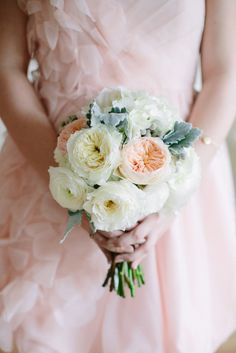 peach bridesmaid dresses with white and peach wedding bouquet. See more of this wedding here. http://www.weddingchicks.com/2013/09/11/peach-and-gray-wedding/