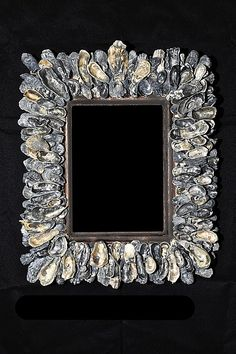 Oyster shell frame--It would be interesting to cover a picture or mirror frame or wreath with oyster shells, mussel shells, & snail shells from the seafood we have eaten.