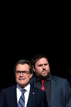 President of Catalonia Artur Mas (L) leaves the Palau de la Generalitat, the Catalan government building, next to the Leader of the Pro-Independence political party Esquerra Republicana de Catalunya (ERC) Oriol Junqueras on September 27, 2014 in Barcelona, Catalonia. President of Catalonia Artur Mas has signed the decree to call for a self-determination referendum from Spain on November 9.