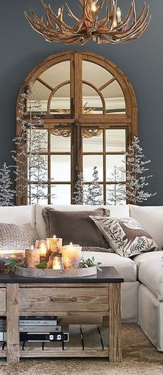 Not into the antler chandelier but love the the room with with many textures