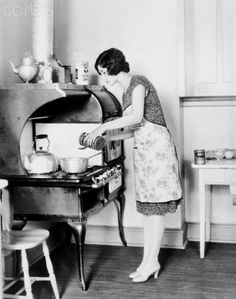 Housewife cooking c 1920's