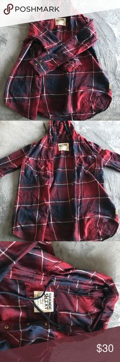 Button up flannel Worn once perfect condition! This flannel has a good attached and it's perfect for fall!! Great to pair with a scarf and some boots or with yoga leggings! Garage Tops