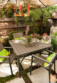 Small Patio Decorating Ideas: A gorgeous small condo patio with Hampton Bay patio furniture, DIY outdoor chandelier and greenery
