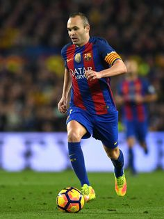 Andres Iniesta of Barcelona in action during the La Liga  match between FC Barcelona and Real Madrid CF at Camp Nou on December 3, 2016 in Barcelona, Catalonia.