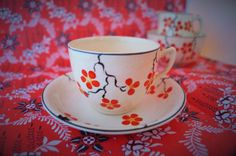 A rare handpainted art deco cup and saucer with chinese style orange and yellow flowers with bold black detail , 'Homeleigh Ware'. by Alexsprettyvintage on Etsy