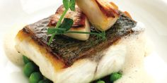 Mark Jordan pairs fresh shelled peas with seared scallops in this pan roasted sea bass fillet recipe, which makes for a magnificent summer meal.