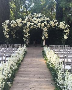 Just when think you've seen every beautiful floral arch, Mark's Garden creates this curved design for a #BeverlyHills #wedding covered in scaling white roses and greenery! | Photography Courtesy of Mark's Garden. | WedLuxe Magazine | #luxury #wedding #luxurywedding #weddinginspiration #decor #weddingdecor #floral #floralarch