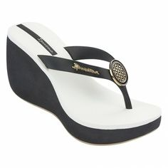 aa5e79e938e57 Black platform flip flop wedge with a cushioned white foot bed and a gold  sole. Ipanema USA