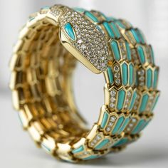 Bulgari's turquoise and diamond secret watch features the famous serpent, which has been in Bulgari's collections since the 1940s. Discover the famous icons of Bvlgari's past, including the Serpenti: http://www.thejewelleryeditor.com/jewellery/bulgari-history-of-style-celebrities-iconic-design/ #jewelry