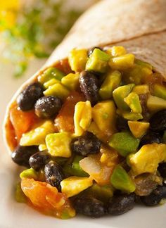 These Avocado and Black Bean Wraps are so easy to make, you could do it in your sleep! With only two steps to whip up this easy snack, you'd be crazy not to make it!