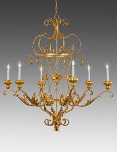 Metal and wood criss cross, tassel and leaf design six light chandelier. Shown in standard antiqued gold metal leaf finish. Style LCFI-45. 46 H x 44.5 W x 44.