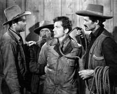 Henry Fonda (left); Dana Andrews (2nd from right); others unidentified in a scene from THE OX-BOW INCIDENT, 1943.