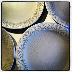 Dinner plates with carved rims.
