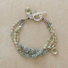 In a palette both soft and soothing, green amethyst briolettes drip from processions of chrysoberyl and moss aquamarine. A handcrafted exclusive with...
