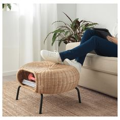 GAMLEHULT Footstool with storage, rattan, anthracite. Made of hand-woven rattan, a living material that makes each footstool unique. You can also use it as extra seating or hidden storage under the seat.