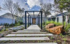 This pergola acts a a threshold between the foyer and outdoor area. Farmhouse Design, Modern Farmhouse, House Entrance, Bay Window, Foyer, Facade, Outdoor Living, Pergola, Spaces