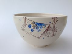 This bowl is intended to be well used and well loved. Based on the size of it, it can be used as a individual rice/ noodle bowl or as a small serving bowl. This piece is thrown on the wheel, the colour is hand-painted when the clay is wet. The print is applied in a third firing
