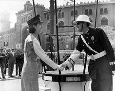A Hong Kong Policewoman Shaking Hands with a Spanish Policeman, 1966 -