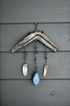 This beautiful mobile is made with driftwood, two 3 abalone shells, strands of polished shell beads and a wonderful slice of blue agate! Driftwood Mobile, Driftwood Art, Seashell Crafts, Beach Crafts, Driftwood Projects, Ideias Diy, Sticks And Stones, Shell Art, Nature Crafts