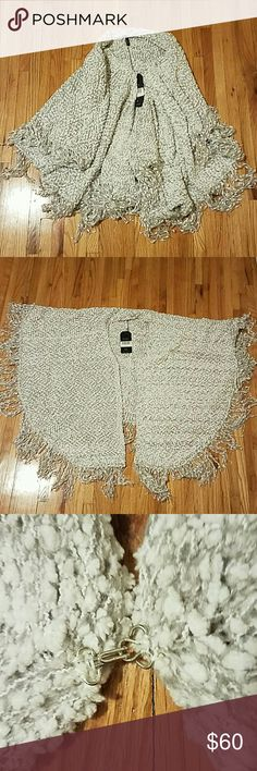 Elan Fringe Sweater Poncho Super soft and luxurious. Fringe detail. Silver clasp in the front. Elan Sweaters #shrugs & Ponchos