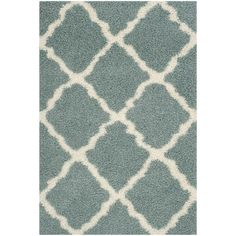 Anchor your living room seating group or define space in the den with this artfully loomed rug, featuring a rich shag pile for a touch of texture.