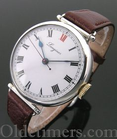 An early round silver vintage Longines watch with centre sweep seconds, 1923