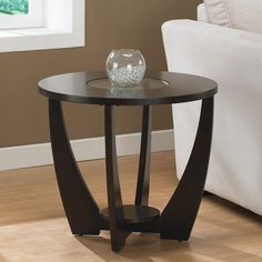 Lend your space a stylish air with this espresso birch end table. This end table features a rounded top with a glass insert and solid-wood legs with non-marring foot glides. A bottom storage shelf on this table makes it as functional as it is lovely.