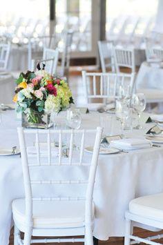 WHITE WEDDINGS. All white table setting with a centrepiece of summer flowers. Wedding Gallery | Hire Ideas & Inspiration | Your Event Solution | YES #weddings #YourEventSolution