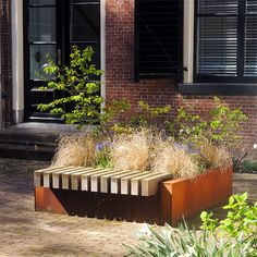 STREETLIFE R&R Big Green Benches. These BGI's are made of weathering resistant steel with a FSCHardwood sitting edge. The wooden beams are for the most part embedded in the steel structure making the benches extremely solid but yet movable