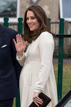 Kate wore a JoJo Maman Bébé coat on visit to Pegasus Primary School