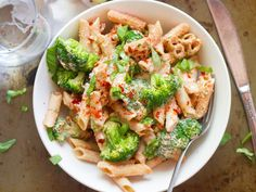 Penne pasta and broccoli florets are tossed in a creamy cashew sauce with sun-dried tomatoes, basil and walnuts to make this luscious vegan dinner.