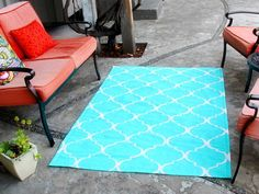 DIY Network has instuctions on how to make an outdoor rug from a painter's drop cloth, paint and stencils.