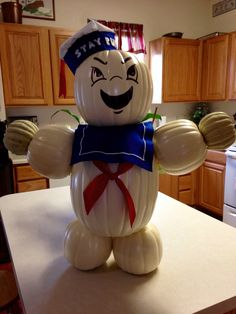 Ghostbusters marshmallow man. Used white pumpkin from craft store, felt, fabrics to make costume.
