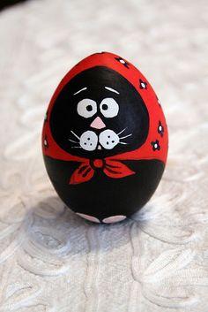 Babushka cat painted on wooden egg