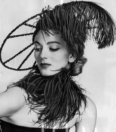 Carmen Dell'Orefice wearing a hat by Mr. John, 1951  Carmen still a model, oldest one to still be working.  She was lovely then, more lovely today!~