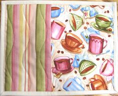 **THIS IS A ONE OF A KIND SET**    A variety of coffee cups and muted stripes cover the front of this set. Soft pastel colors in multiple shades of pink, olive, blue, and others pulls this feminine look together. The stripe has also been used for the backing. A mixture of machine quilting shows stippling on the coffee cup print and 3 wavy lines (depicting steam) on the striped fabric.    These mats are big enough for your beverage mug and a snack. They protect your tables from heat and…